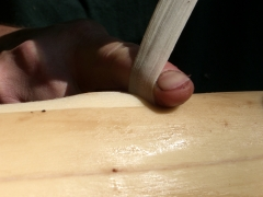 Pulling against a finger on top